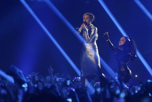 "AMSTERDAM (AP) — Miley Cyrus opened MTV's Europe Music Awards with her hit song ""We Can't Stop"" — while wearing a space-themed silver spandex suit and twerking with a female dwarf."