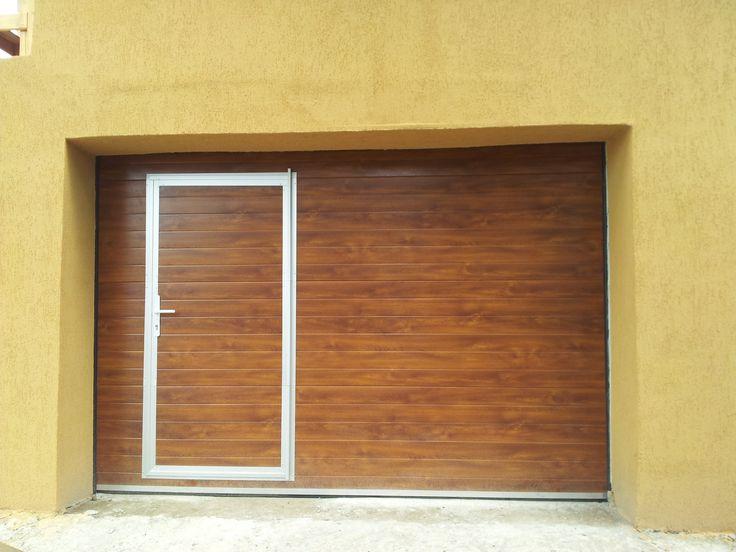 Usa de garaj sectionala cu usa de acees pietonal. http://www.usidegarajcluj.info