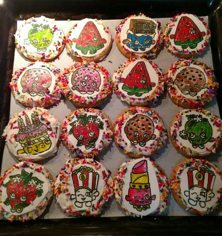 Shopkins sugar cookies with butter cream icing.  decorations are hand drawn on sugar sheets and then painted. made original pictures in black and white then placed sugar sheet over it and traced images.   Finished cookies sprinkled with colored sprinkles.