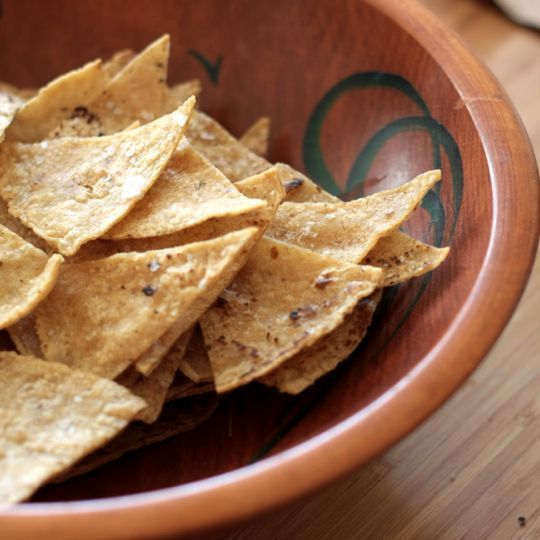 How to Make Tortilla Chips in the Oven  What You Need    Ingredients  Good-quality corn tortillas  Neutral vegetable oil, like grapeseed or canola  Flaky sea salt    Equipment  Brush for the oil  Baking trays  Cutting board  Large sharp knife