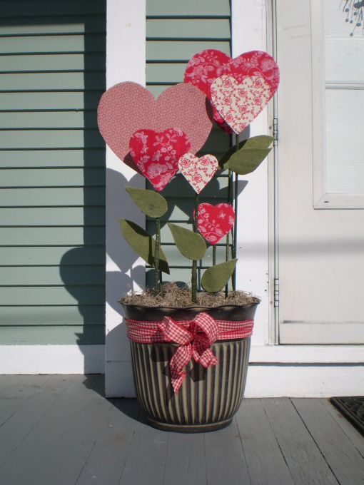 A pot of fabric-covered hearts for indoors or outdoors ~ cardboard or foam core for hearts.: