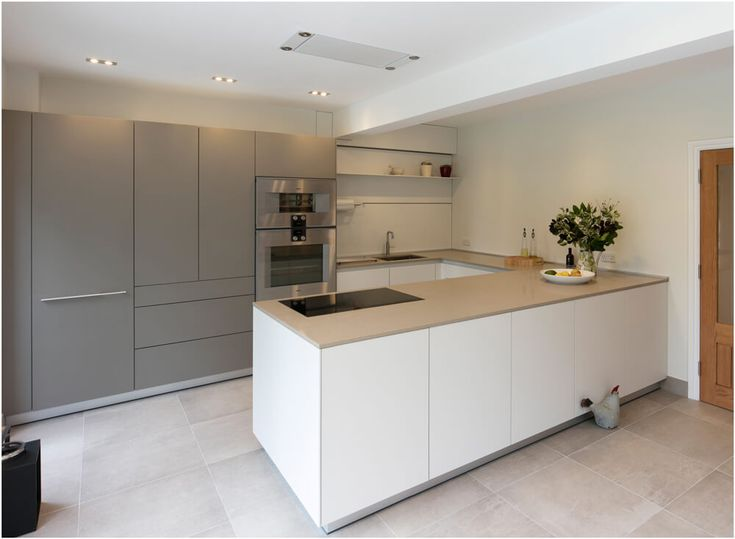 An understated contemporary bulthaup b3 kitchen, finished in Flint and Kaolin laminates with a polished Caesarstone worktop and Gaggenau appliances.