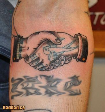 Harry styles handshake tattoo