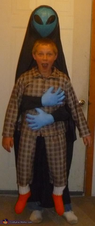 Alien abduction costume. The boy's legs are the alien's legs. Lots of great costume ideas.
