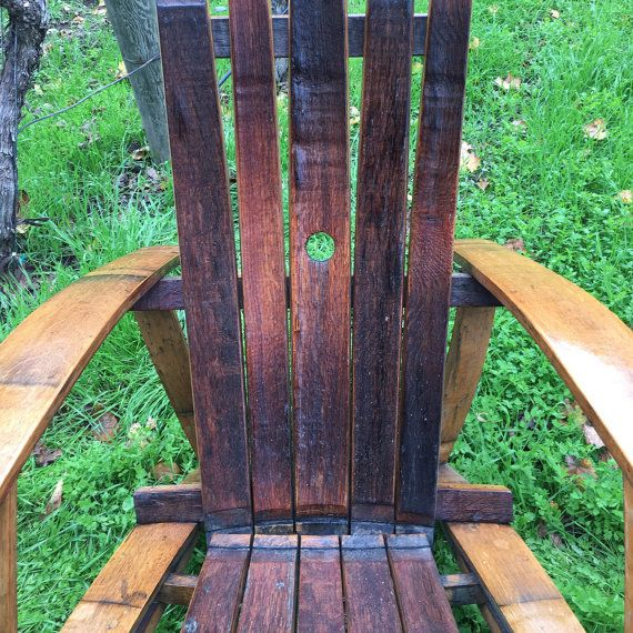 The perfect porch chair, available with optional custom wine glass holder for the arms.  My adirondack chairs are built from wine barrels in the Napa valley. Each has unique color variations from the wine staining and barrel charring that each barrel picks up during its life as a wine vessel. The chairs are finished in Tung Oil, an all-natural indoor/outdoor finish, and have craftsman finishing details including countersunk screws and hidden fasteners with handmade wood plugs.  The end r...