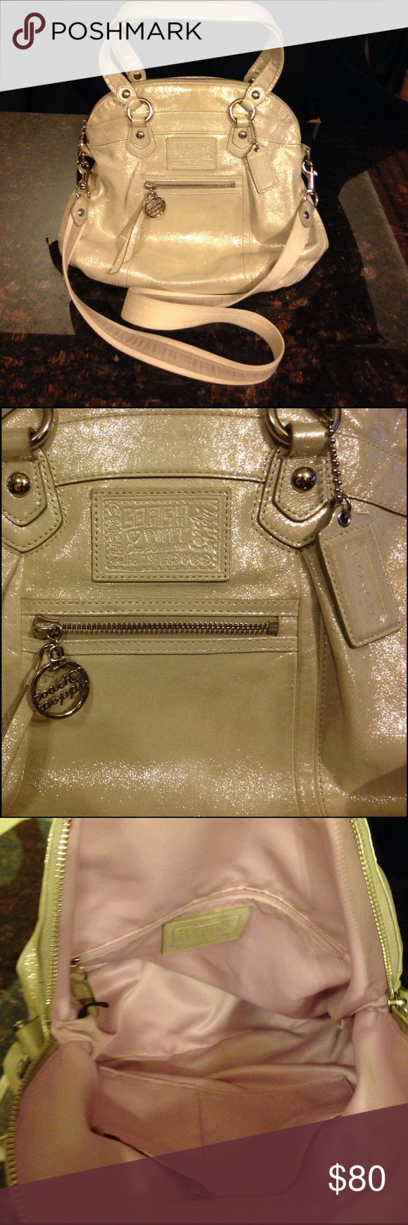"Coach Poppy Highlight in Platinum # 16283 Coach Poppy Highlight # 16283 in Platinum. Silver colored hardware with lavender satin lining. Measures 14"" x 13"" x 4"" with a 7 1/2"" drop. Also includes the long cross-body strap. Coach box, dust bag & original price tag too!  Good used condition with no Major flaws - just normal wear from being carried. Coach Bags Shoulder Bags"