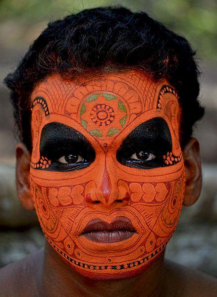 Make up of Vishnumoorthi Theyyam.