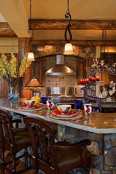 Love the bar area, the wood beams on the ceiling and the lights in this kitchen.