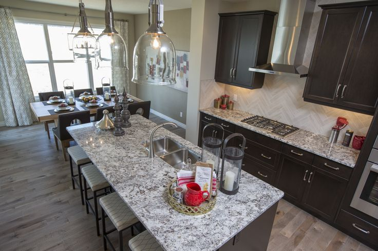 The Kennedy II Kitchen In Nolan Hill – Trico Homes – Check out the new homes built by www.tricohomes.com #homebuilder #tricohomes #calgary