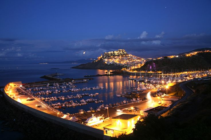 Castelsardo and its harbour at night.