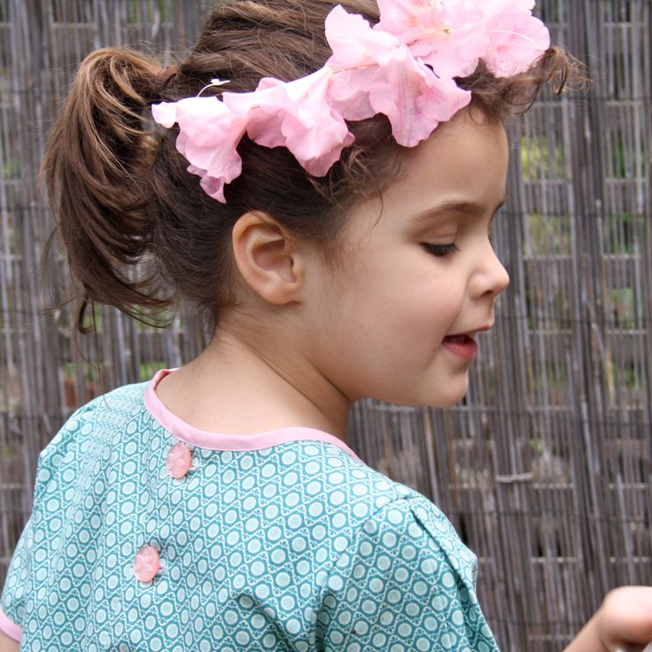 pink buttons on an antique mint dress. 'Tea in the Garden' dress by Little Emperor: http://littleemperorclothing.com.au/collections/girls/products/tea-in-the-garden-dress