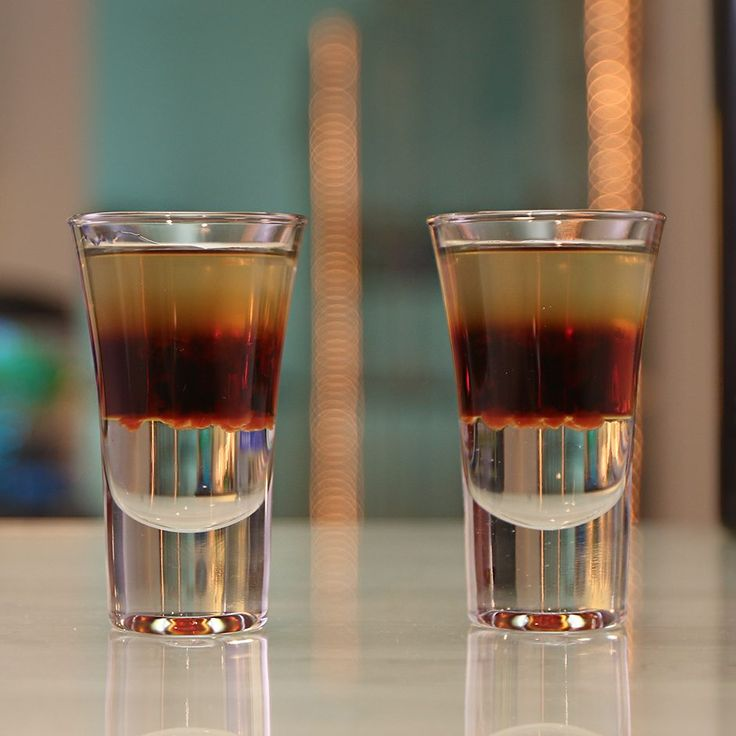 CHUCK NORRIS ROUNDHOUSE KICK TO THE FACE SHOT 1 part Sambuca 1 part Jägermeister 1 part Absinthe 5 Drops Hot Sauce (Sriracha) PREPARATION 1. Pour Sambuca into the base of a shot glass and carefully layer Jägermeister over. 2. Top with a layer of Absinthe and drop in Sriracha hot sauce. DRINK RESPONSIBLY!