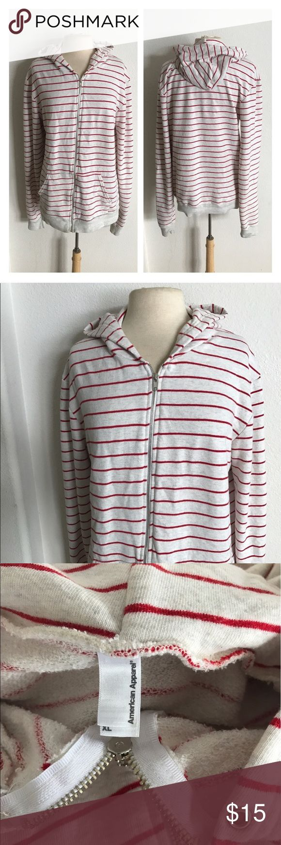 """American Apparel Men's striped zip up hoodie American Apparel red/ beige striped zip up hoodie. Men's hoodie size XL. Owned and worn by me and fit perfectly when I was a 14/16. Measures 29"""" long with a 42"""" bust. 70% cotton/ 30% polyester. This has some weight to it! Two functional front pockets. Missing drawstring. This does have some pilling throughout which has been reflected in the price.  💲Reasonable offers accepted ✅Bundle offers American Apparel Jackets & Coats"""
