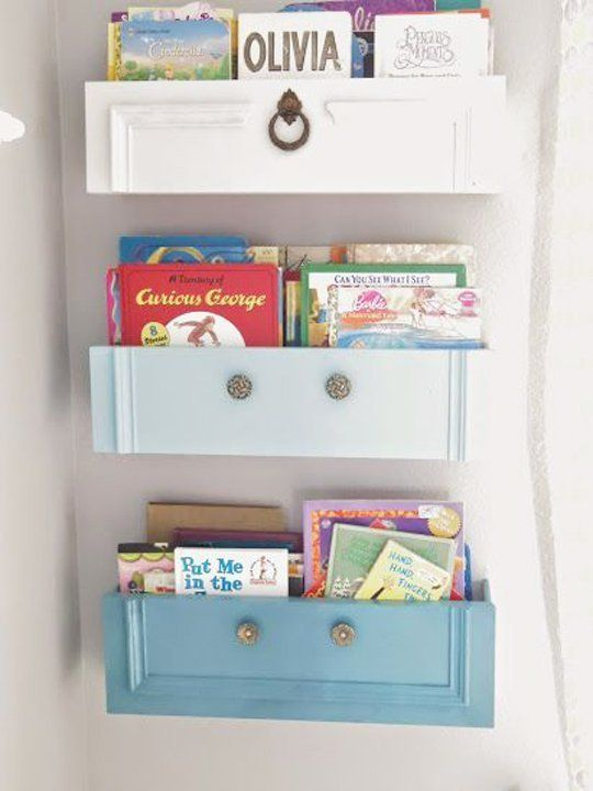 Using dresser doors as a unique and stylish solution to keep books organized and off the floor,