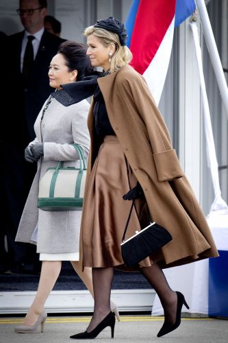 Queen Máxima, and Chinese First lady Peng Liyuan. I would call this outfit a miss.