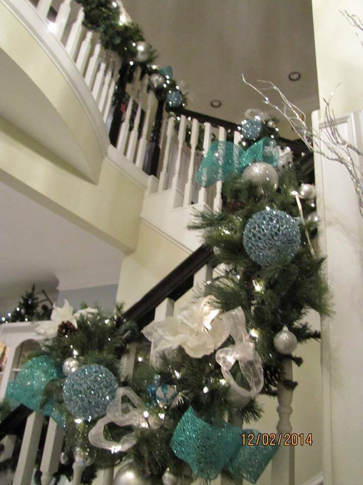 Christmas Garland On Stairs With Blue Silver And White