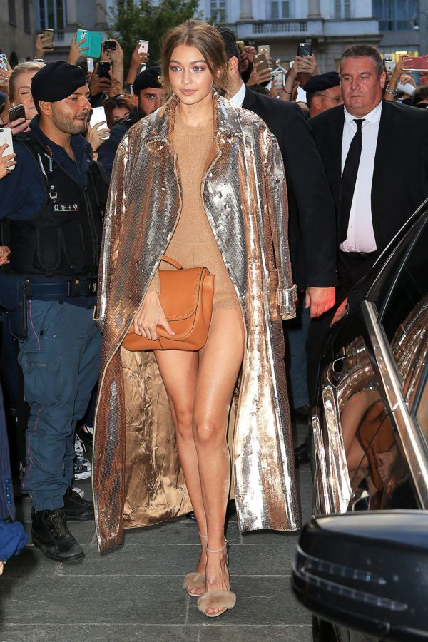 Gigi Hadid - Arriving at a Max Mara soiree, the It girl turns heads as she shows off her legs in a nude bodysuit and dazzling sequined coat.