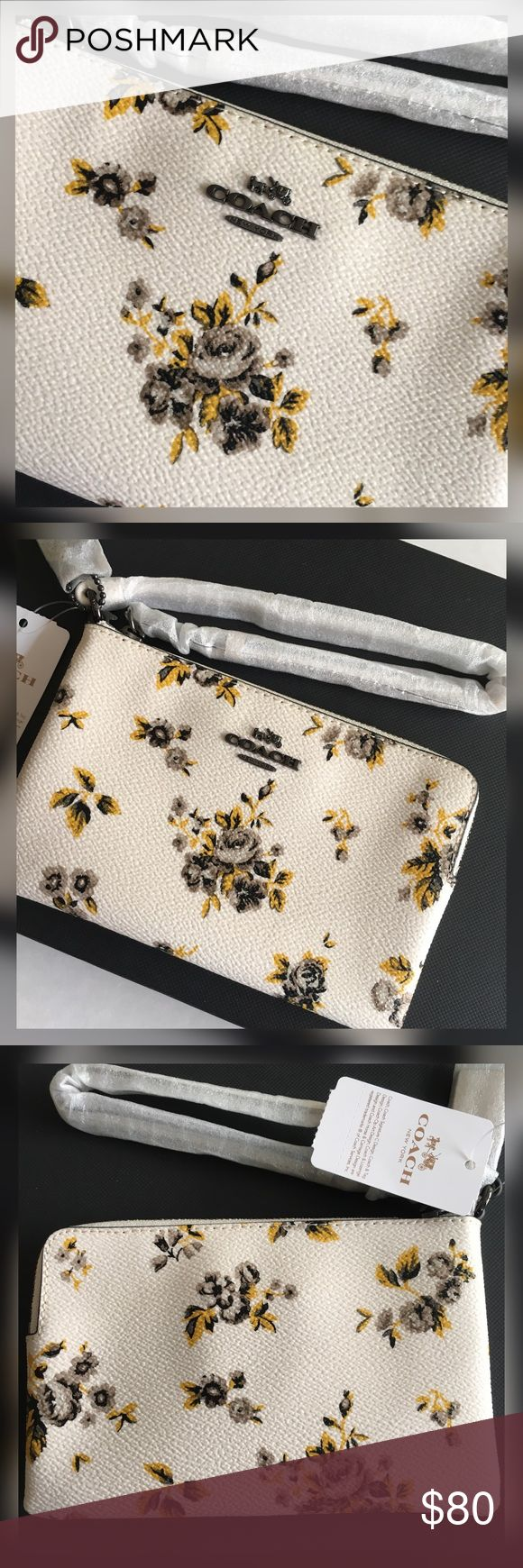 """Coach Wristlet Perfectly sized for cards, cash and phone, this petite canvas wristlet in a vintage-inspired prairie floral print can be worn on the wrist or clipped inside of a larger bag.     Two credit card slots Zip-top closure, fabric lining Strap with clip to form a wrist strap or attach to the inside of a bag 6 1/4"""" (L) x 4"""" (H) Fits an iPhone or Android Coach Bags Clutches & Wristlets"""