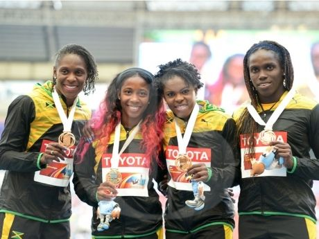 Green, Gold Reign Supreme As World Championships End Ricardo Makyn photo - Jamaica\'s 4X100 relay team: Carrie Russell, Kerron Stewart, Schillonie Calvert and Shelly-Ann Fraser Pryce pose with gold medal.