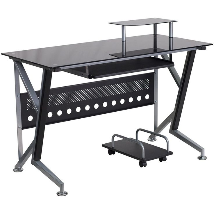 Black Glass Computer Desk with Pull-Out Keyboard Tray and CPU Cart. This computer station offers a modern touch with black glass surfaces. Investing in a desk for your home makes working from home or managing household bills and paperwork a nicer experience. The raised monitor shelf gives you more work space for your paperwork and writing utensils. The pull-out keyboard platform can store your keyboard away when no longer needed for a clean appearance. This desk also features a privacy panel…
