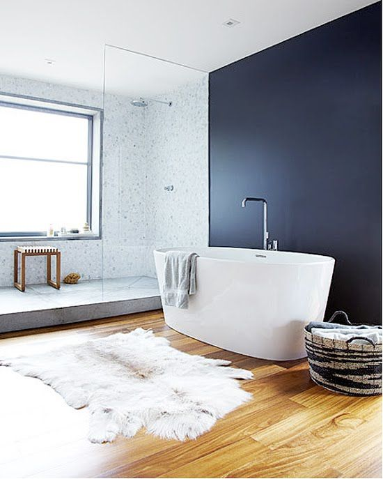 black wall, white bath, light grey tiles perfect for kids