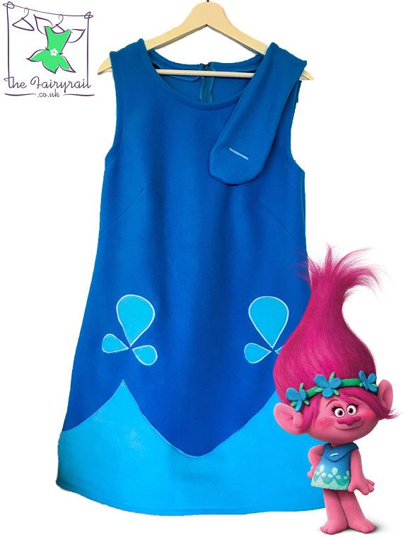 Hi and welcome to the Fairyrail!! This outfit is so cute!!! The Poppy dress is made from turquoise blue and pale blue fleece and has a zipper fastening to the back. It can be lined at an extra cost if you prefer otherwise it comes unlined. The dress is slightliy fitted at the bust and back. Team these up with some pink leggings and a pink long sleeved top and you are good to go! Our Poppy Headband can be purchased seperately. Payment PayPal, credit card and debit cards. Orders can be ca...
