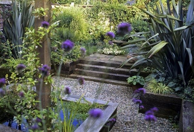 Railway sleeper steps and edging with Phormium and Verbena bonariensis / repinned by Llewellyn Landscape & Garden Design www.llgd.co.uk | creative design for the landscape of your dreams