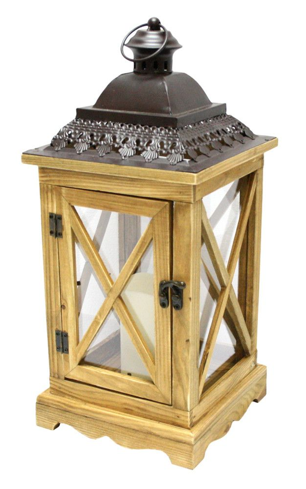 Rustic natural wooden lantern has glass panes and an elegant cut-out brown metal top Beige bisque flameless pillar candle has the look of a real wax candle with the safety of battery operation Amber c
