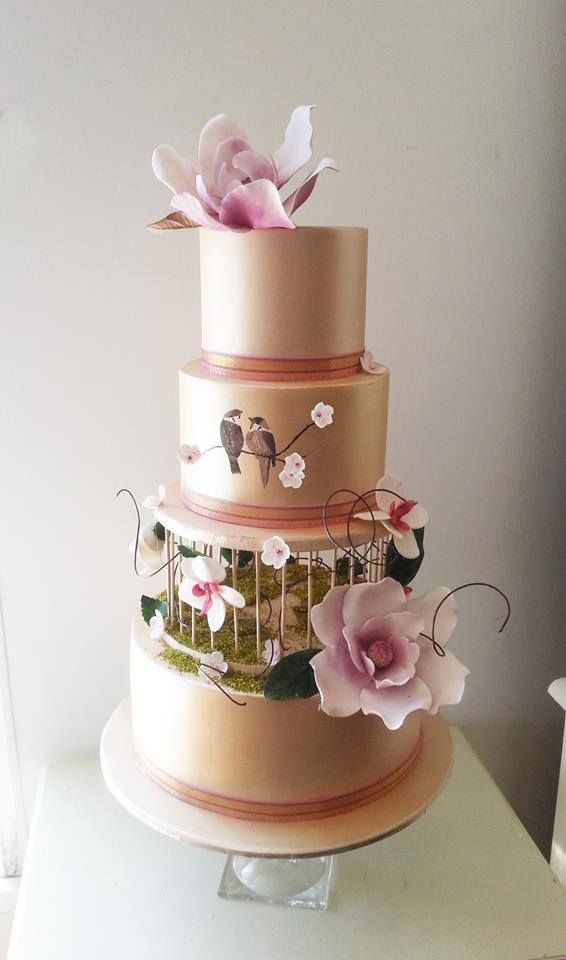 Gold wedding cake featuring birds and flowers - by Cake Face