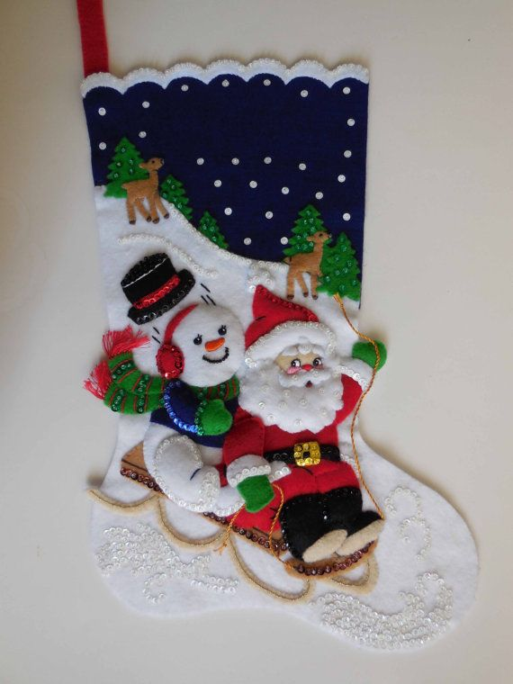 Made from a hard-to-find Bucilla kit, this stocking measures 18 from hanger to toe. Lightly stuffed, it comes with a lot of sequins/beads, felt
