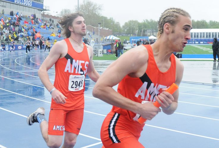 Ames' Gauge Sletten and Brandon Cable exchange the baton during the 4x200-meter relay at the Drake Relays on Friday at Drake Stadium in Des Moines. Photo by Nirmalendu Majumdar/Ames Tribune http://www.amestrib.com/sports/20170428/track-and-field-ames-sends-two-relays-to-finals