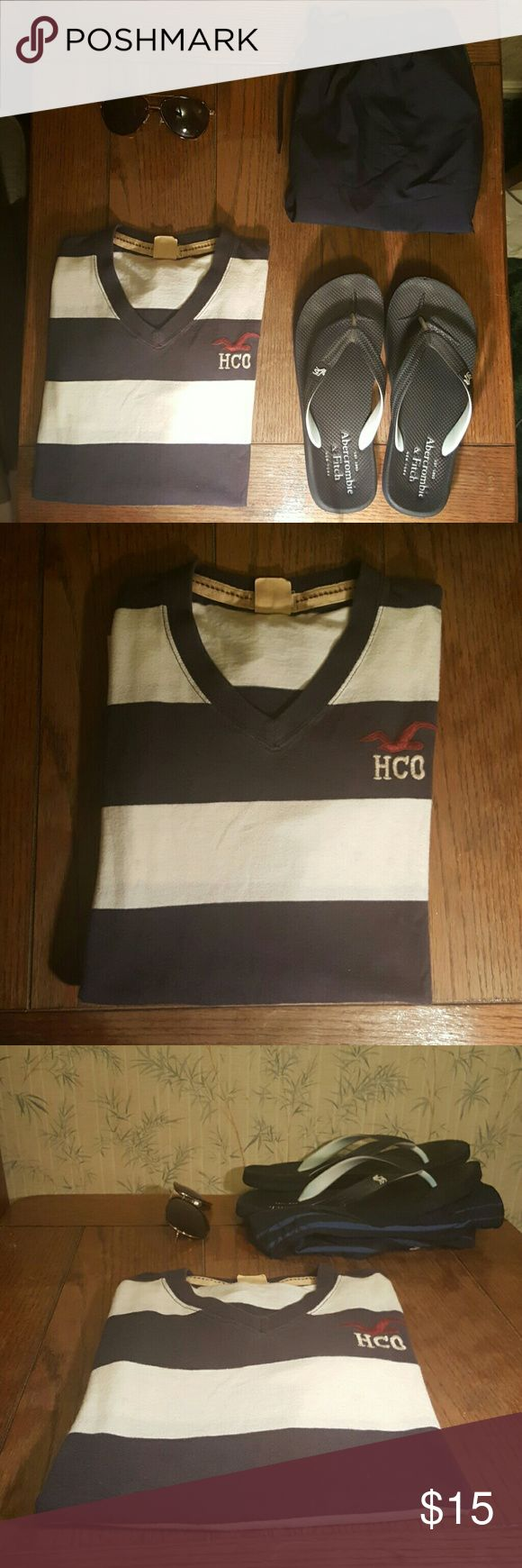 HOLLISTER TEE (small) Cotton vneck striped tee! ready to hit DA beach ? Perfect in style tee to make you look like you own that beach.you are the sailor in this shirt You Can dress it up with a good old pair of jeans and a cardigan or dress it down with shorts/swimsuit and flip flops!  never worn perfect mint condition! All reasonable offers accepted Hollister Shirts Tees - Short Sleeve