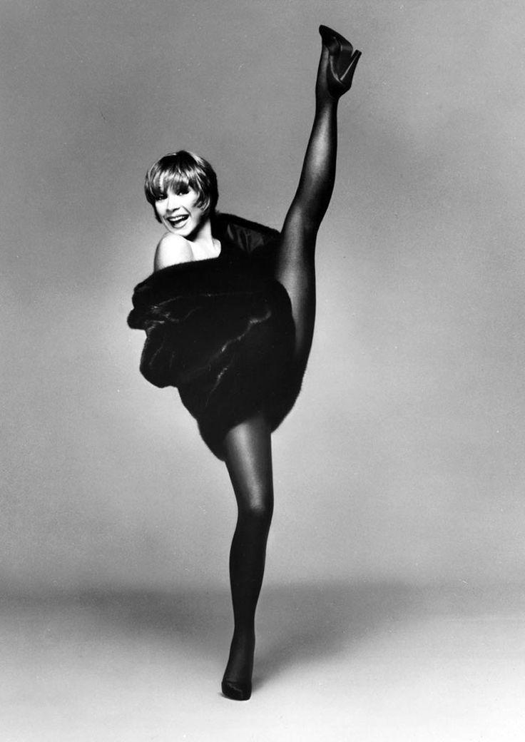 Shirley MacLaine. Performance and movement. This image shows the model is clearly used to being in front of the camera as her facial expression is quite relaxed.