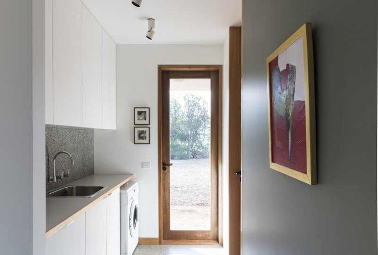 Fascinating Eco Friendly House Provides Cozy Minimalist Interior: White Cabinet In Fantastic Natural Eco Friendly House Concept Ideas Design With Wooden Trim Around Glass Door And Wall Is Painted In White Also Grey Color With Grey Marble Backsplash And Washing Machine