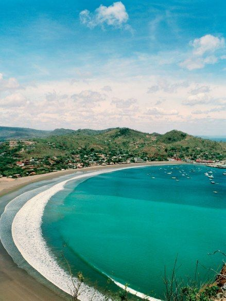 A young international crowd flocks to the town of San Juan del Sur for the superb waves—and the après-surf scene. Here, the bay of San Juan del Sur. (via Condé Nast Traveler)