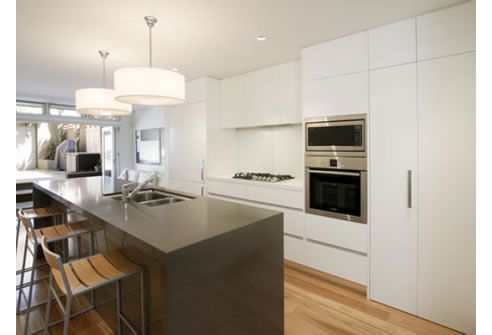 nice colour blocking- all white back wall with dark island. blackbutt timber floor