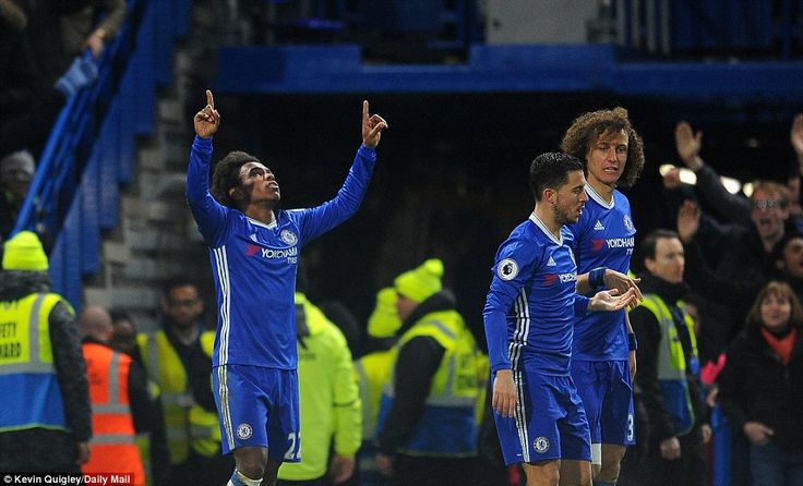 Willian looks up to the sky after scoring his first goal of the afternoon for Chelsea against Stoke