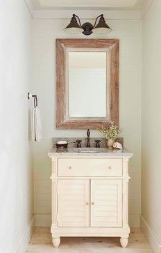 Rustic light, simple accessories, weathered mirror