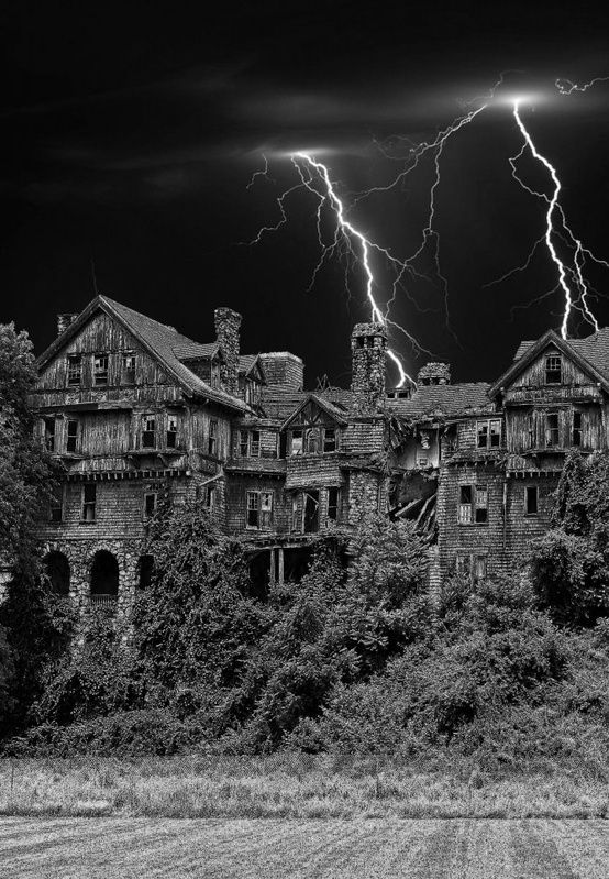 Creepy old house with lighting in the air.