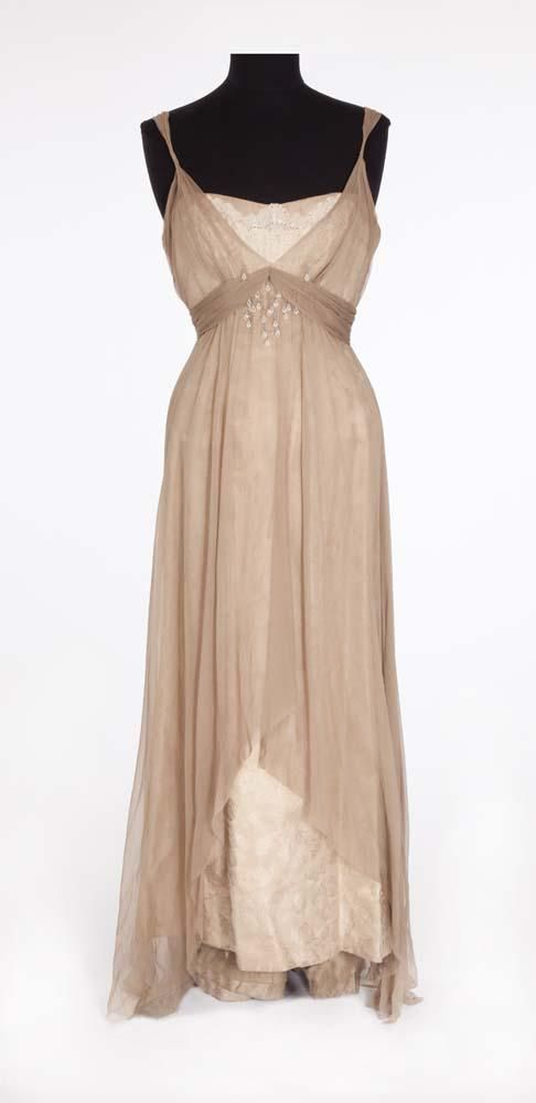 """Taupe silk gown of floral brocade and tulle with lace bust embellished with crystal jewels and rhinestones on the bodice and pink chiffon across the torso and at the back. Worn by Debbie Reynolds as """"Molly Brown"""" in The Unsinkable Molly Brown (1964)"""
