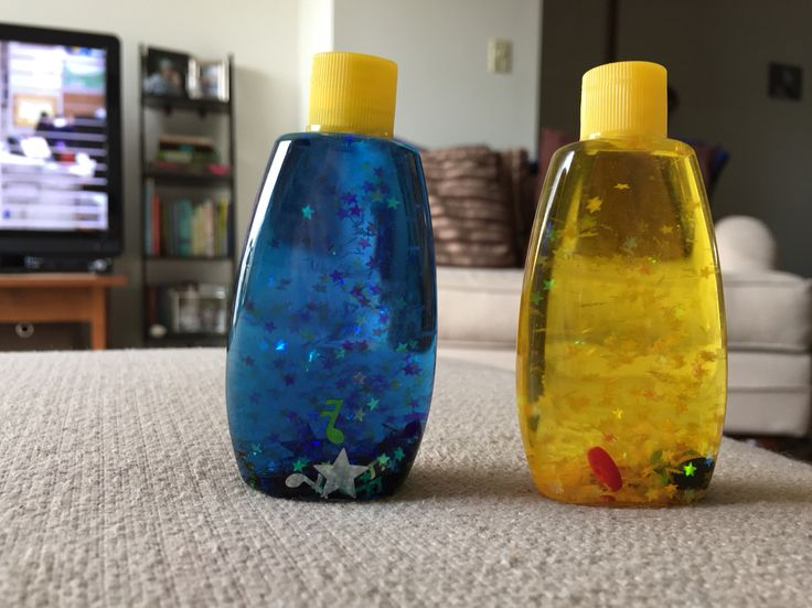 Baby sensory bottles! Trial size baby shampoo bottles filled with glitter, water, food coloring and then hot glued shut. Sooo cute!