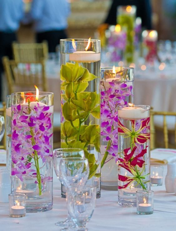 submerged flowers with floating candles