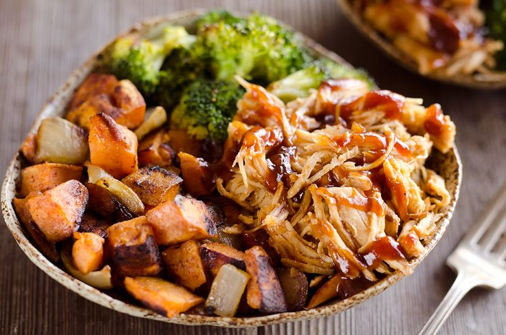 BBQ Chicken & Roasted Sweet Potato Bowls are a hearty and healthy dinner idea made on a sheet pan bursting with bold flavors and nutritious vegetables.