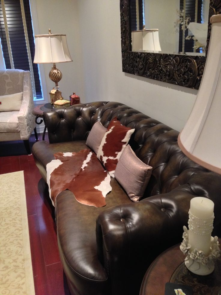 Brown hand rubbed chesterfield leather sofa with