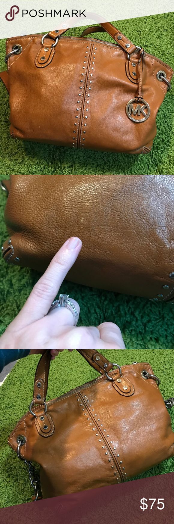 Michael Kors brown handbag Lovely saddle brown with silver hardware. Carried; exterior gets an 8 out of 10 for condition. Interior gets a 7 out of 10 due to cone pen marks to very bottom & some dingy spots. This is a beautiful quality bag with lots of life to give. Measures 15x11 so Medium-to-Large in size. Comes with its dust bag. Bundling is fun! Check out my other items. No trades or holds. No price talk in comments. MICHAEL Michael Kors Bags Satchels