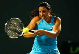 Marion Bartoli of France in action against Victoria Azarenka of Belaraus during Day 10 of the Sony Ericcson Open at Crandon Park Tennis Center on March 28, 2012 in Key Biscayne, Florida
