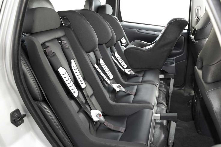 4-child <br>car seat converts a 3 wide seat to 4. Works across all sizes. ~about $2000 which is cheaper than buying a new car and less cumbersome and safer than 3 car seats trying to squeeze in.