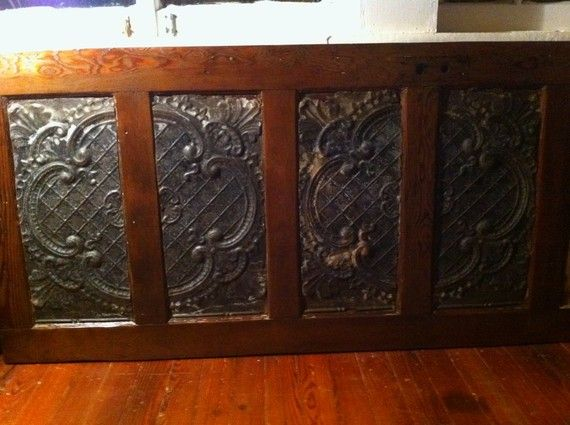 Door and old ceiling tile become fab headboard.