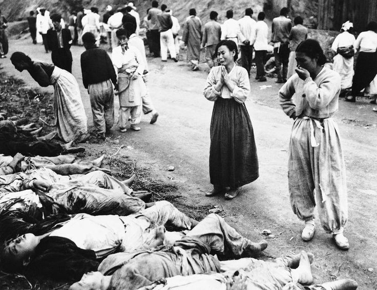 Korean women weep as they identify bodies on Oct. 28, 1953. The army said the victims were among political prisoners killed by suffocation by the Communists outside Hambung, Korea. The Army said the victims were forced into caves which were then sealed off. (AP Photo)