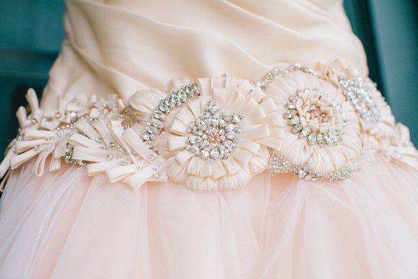 The beaded belt featured flowers and rhinestones.   Venue: Magnolia Plantation and Gardens  Dress Designer: Lazaro